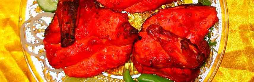 Pollo Tandoori en cocina del Punjab